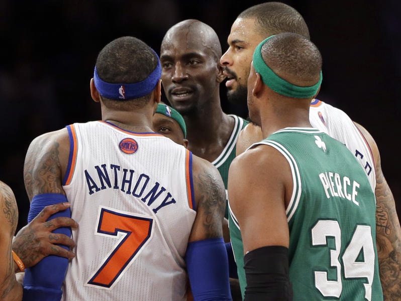 """In this photo taken Monday, Jan. 7, 2013, New York Knicks' Carmelo Anthony (7) and Boston Celtics' Kevin Garnett, center, exchange words after both received technical fouls as Celtics' Paul Pierce (34) and Knicks' Tyson Chandler look on during the second half of an NBA basketball game at Madison Square Garden in New York. Anthony said Tuesday, he lost his cool after Garnett said things to him that he feels shouldn't be said to """"another man."""" (AP Photo/Kathy Willens)"""