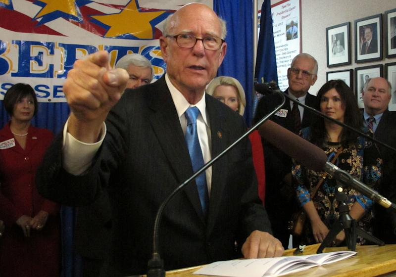 In this photo from Friday, Nov. 8, 2013, U.S. Sen. Pat Roberts speaks during a campaign rally in Overland Park, Kan. The veteran Republican senator is facing questions about whether he lives in Dodge City, Kan., or the Washington area. (AP Photo/John Hanna)