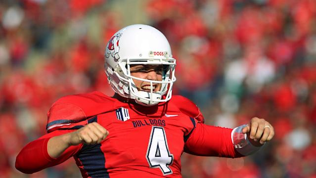 Fresno State quarterback Derek Carr celebrates a touchdown pass against New Mexico in the first half of an NCAA college football game in Fresno, Calif., Saturday, Nov. 23, 2013. (AP Photo/Gary Kazanjian)