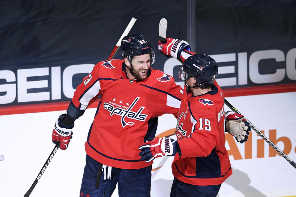 Washington Capitals right wing Tom Wilson (43) celebrates his second goal of the game with center Nicklas Backstrom (19) in the second period of an NHL hockey game against the New York Rangers, Sunday, March 28, 2021, in Washington. (AP Photo/Nick Wass)