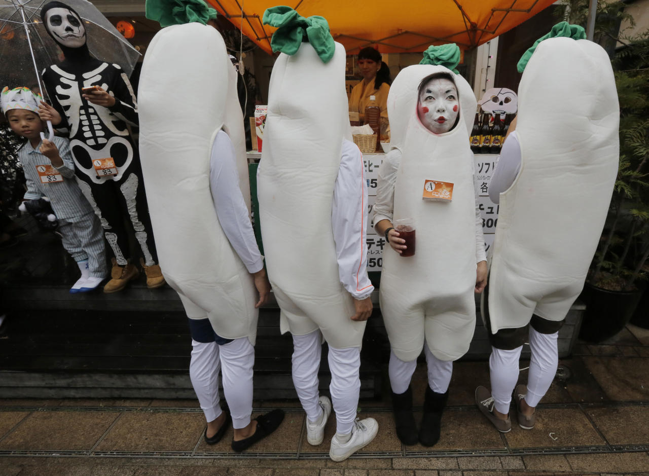 A costumed woman takes a break with her friends at an Halloween event in Kawasaki, near Tokyo, Sunday, Oct. 28, 2012. (AP Photo/Itsuo Inouye)