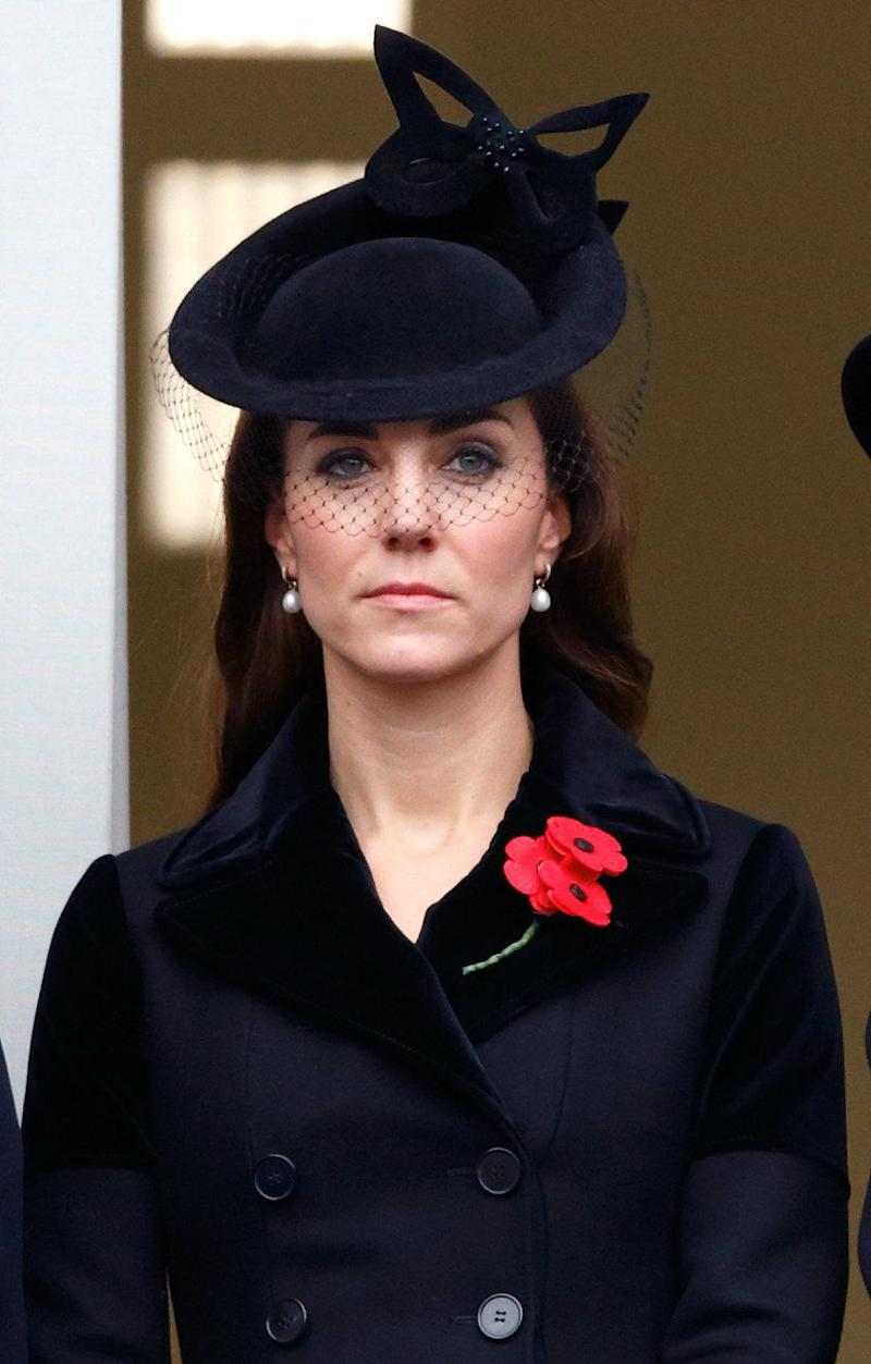 The Duchess of Cambridge wore an all-black ensemble, including an Alexander McQueen coat and Sylvia Fletcher for Lock & Co. hat, to attend the Remembrance Sunday Service in London on November 8, 2015.