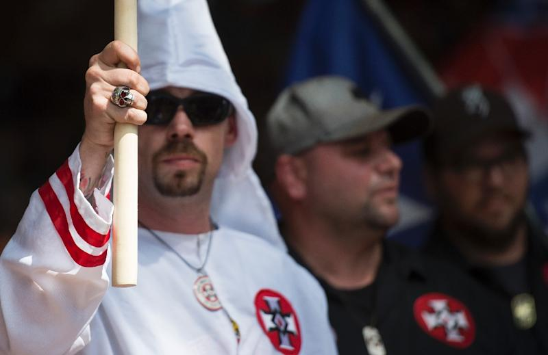Supporters of the Ku Klux Klan hold a rally in Charlottesville, Virginia on July 8, 2017 to protest the planned removal of a statue of General Robert E. Lee, who oversaw Confederate forces in the US Civil War