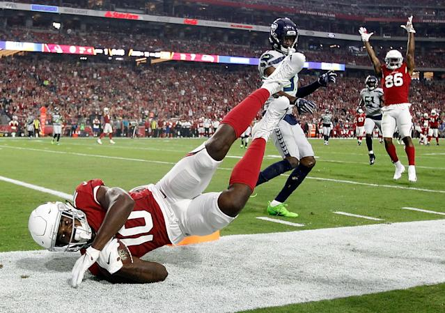 <p>Wide receiver Chad Williams #10 of the Arizona Cardinals falls out of bounds during the first quarter against the Seattle Seahawks at State Farm Stadium on September 30, 2018 in Glendale, Arizona. (Photo by Ralph Freso/Getty Images) </p>