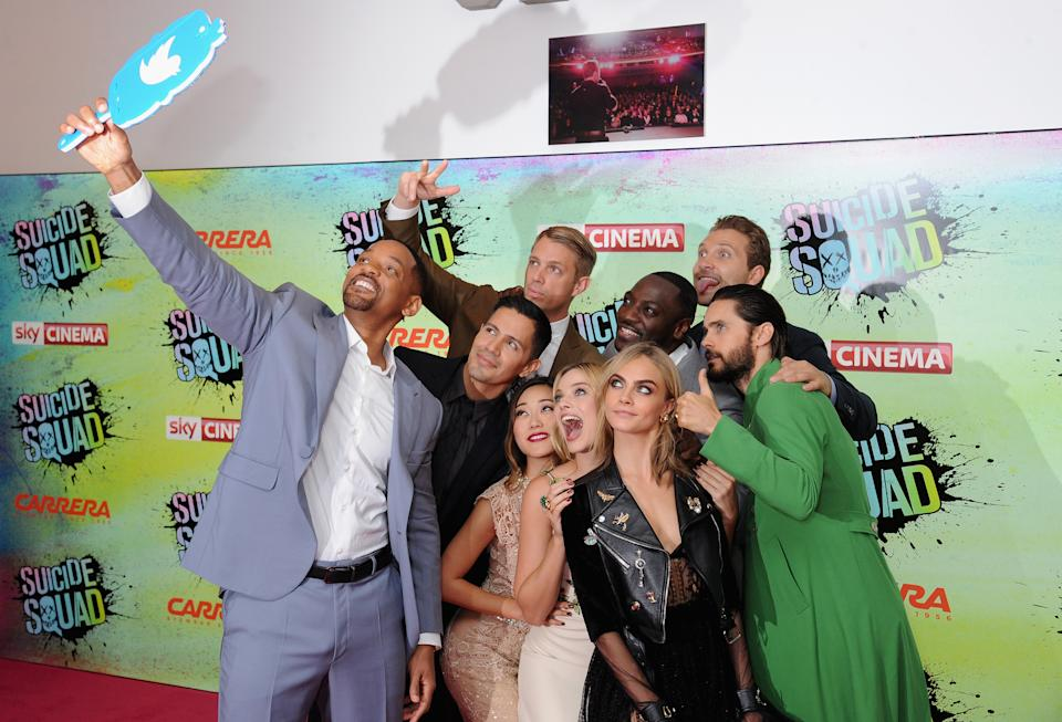 """LONDON, ENGLAND - AUGUST 03:  (clockwise from L) Will Smith poses for a selfie with Jay Hernandez, Joel Kinnaman, Adewale Akinnuoye-Agbaje, Jai Courtney, Jared Leto, Cara Delevingne, Margot Robbie and Karen Fukuhara at the European Premiere of """"Suicide Squad"""" at Odeon Leicester Square on August 3, 2016 in London, England.  (Photo by Dave J Hogan/Getty Images)"""