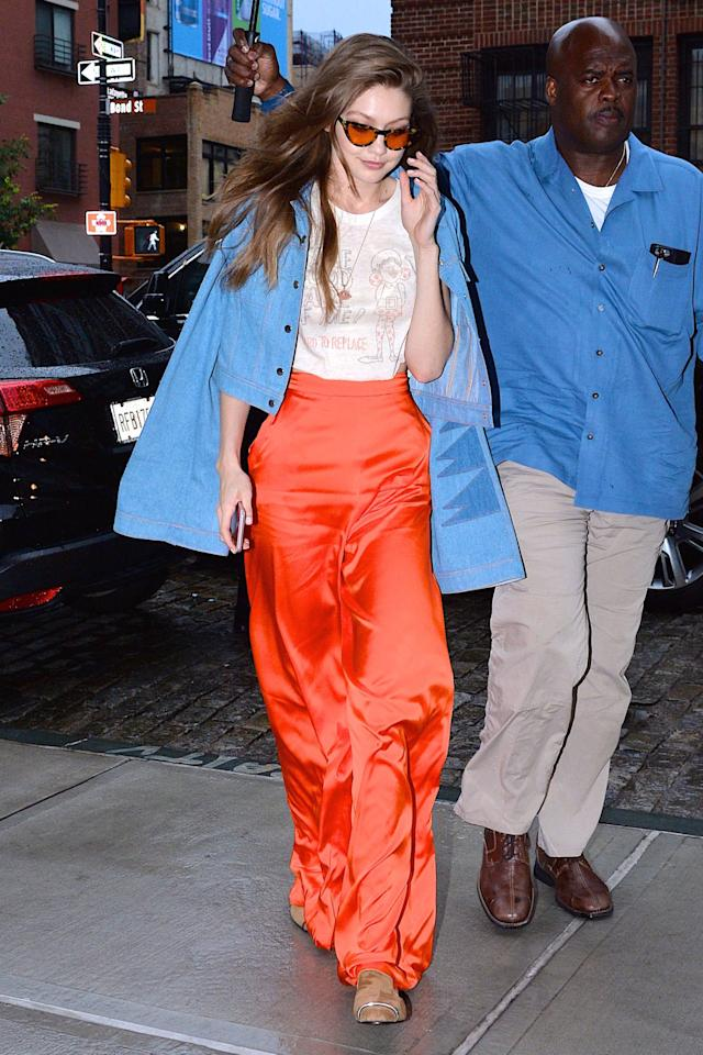 <p>This bold bright shade is shaping up to be one of summer's hottest colors and if you don't believe me, just ask Gigi's pants. Per usual, the model added a bit of retro flare to her fit with a '70s-inspired denim jacket and cat eye sunnies. </p>
