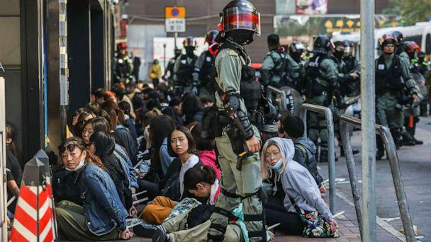 PHOTO: People are detained by police near the Hong Kong Polytechnic University in Hung Hom district of Hong Kong on Nov. 18, 2019. (Dale De La Rey/AFP via Getty Images)