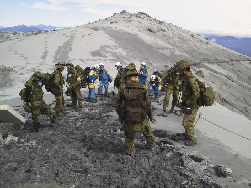 JSDF soldiers conduct rescue operations near the peak of Mount Ontake, which erupted September 27, 2014 and straddles Nagano and Gifu prefectures, central Japan