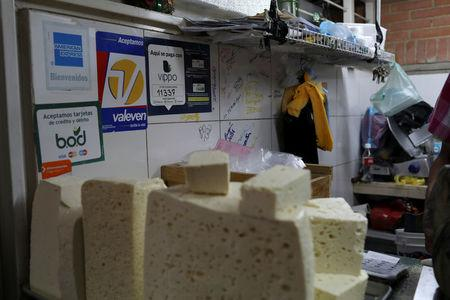Information for Vippo app and other methods of payment is seen at a cheese and dairy products stall at Chacao Municipal Market in Caracas, Venezuela January 19, 2018. Picture taken January 19, 2018. REUTERS/Marco Bello