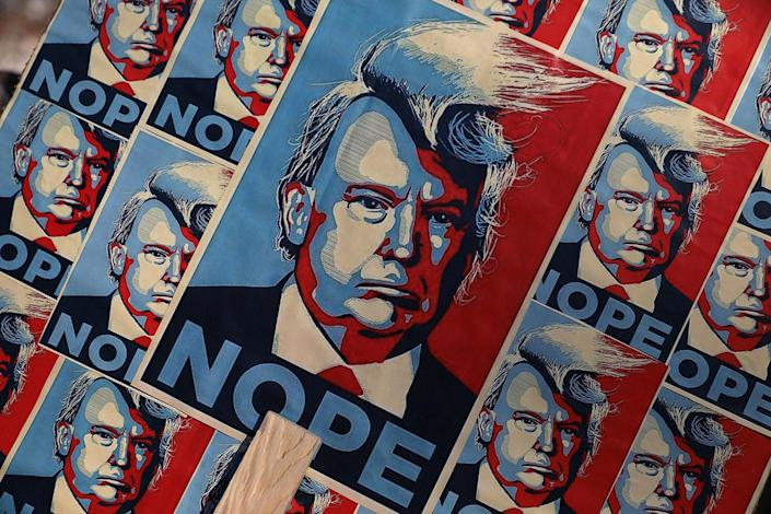 <p>An image of President Donald Trump is seen on a placard during the Women's March on January 21, 2017 in London, England. (Photo by Dan Kitwood/Getty Images) </p>
