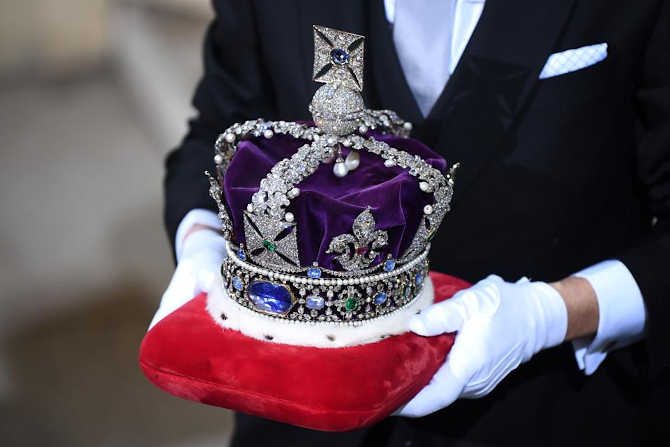 The Imperial State Crown is brought to the Sovereign's Entrance of the House of Lords for the State Opening of Parliament at the Houses of Parliament in London on December 19, 2019. - The State Opening of Parliament is where Queen Elizabeth II performs her ceremonial duty of informing parliament about the government's agenda for the coming year in a Queen's Speech. (Photo by Victoria Jones / POOL / AFP) (Photo by VICTORIA JONES/POOL/AFP via Getty Images)