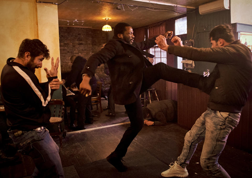 Actor Sope Dirisu in action in the pub fight in episode one of 'Gangs of London'