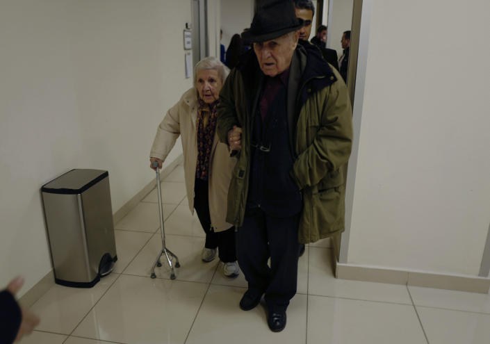 An elderly Turkish couple arrive at a polling station during the local elections in Ankara, Turkey, Sunday, March 31, 2019. Turkish citizens have begun casting votes in municipal elections for mayors, local assembly representatives and neighborhood or village administrators that are seen as a barometer of Erdogan's popularity amid a sharp economic downturn. (AP Photo/Burhan Ozbilici)