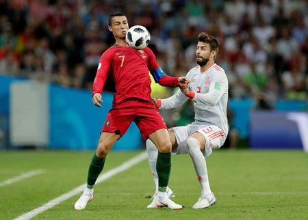 Soccer Football - World Cup - Group B - Portugal vs Spain - Fisht Stadium, Sochi, Russia - June 15, 2018 Portugal's Cristiano Ronaldo in action with Spain's Gerard Pique REUTERS/Ueslei Marcelino