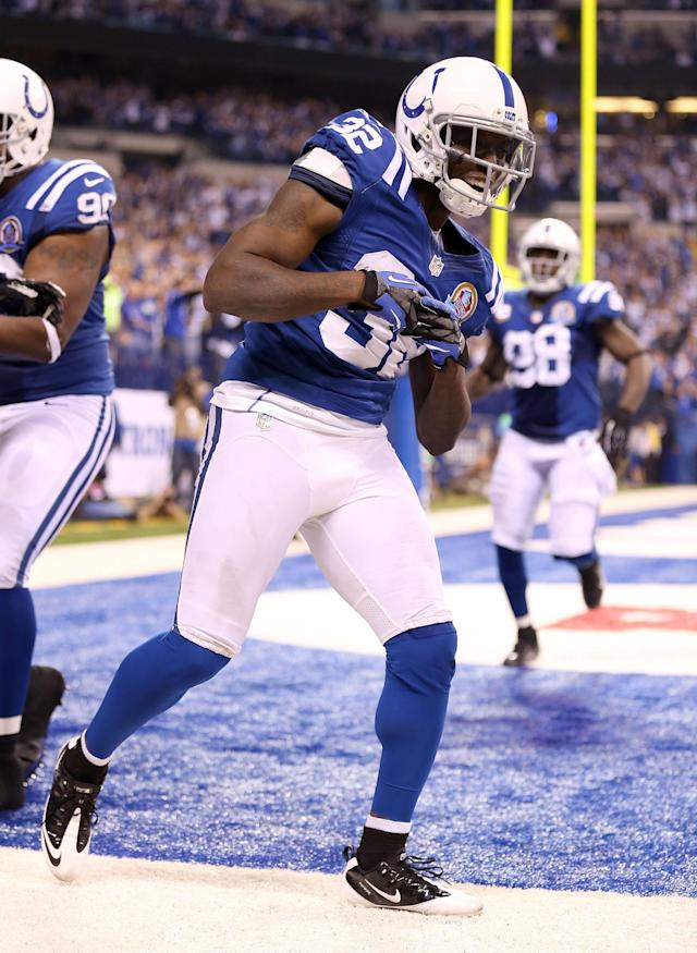 INDIANAPOLIS, IN - DECEMBER 09: Cassius Vaughn #33 of the Indianapolis Colts celebrates after returning an interception for a touchdown during the NFL game against the Tennessee Titans at Lucas Oil Stadium on December 9, 2012 in Indianapolis, Indiana. (Photo by Andy Lyons/Getty Images)