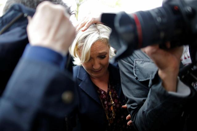 <p>Marine Le Pen, French National Front (FN) party candidate for 2017 presidential election, is protected by bodyguards as eggs are thrown by demonstrators during her arrival in Dol-de-Bretagne, France, May 4, 2017. (Photo: Stephane Mahe/Reuters) </p>