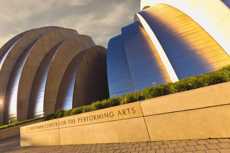 """<p>Directly across the state from St. Louis's gleaming Gateway Arch is the equally stunning <a href=""""http://www.kauffmancenter.org/"""" rel=""""nofollow noopener"""" target=""""_blank"""" data-ylk=""""slk:Kauffman Center for the Performing Arts"""" class=""""link rapid-noclick-resp"""">Kauffman Center for the Performing Arts</a>, located in the heart of downtown Kansas City. The 285,000-square-foot building, which was designed by architect Moshe Safdie and opened in 2011, regularly hosts operas and performances by the Kansas City Ballet and Kansas City Symphony.</p>"""