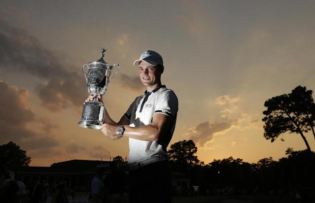 Martin Kaymer, of Germany, poses with the trophy after wining the U.S. Open golf tournament in Pinehurst, N.C., Sunday, June 15, 2014. (AP Photo/Charlie Riedel)