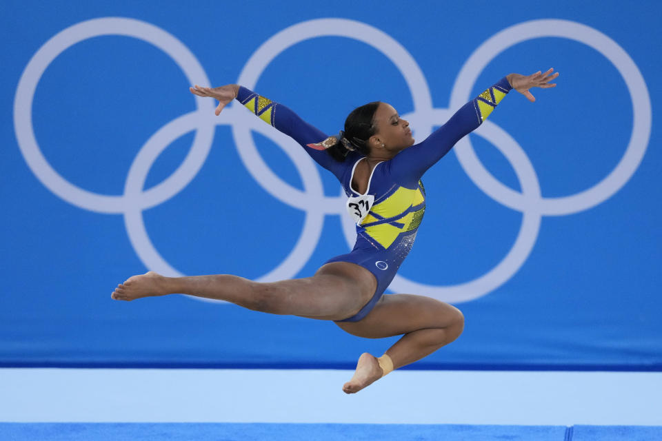 Rebeca Andrade, of Brazil, performs on the floor during the artistic gymnastics women's all-around final at the 2020 Summer Olympics, Thursday, July 29, 2021, in Tokyo. (AP Photo/Ashley Landis)