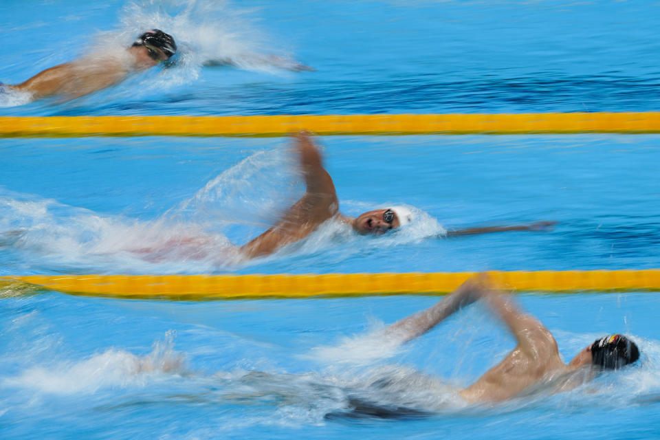 Robert Finke, from top, of the United States, Mykhailo Romanchuk, of Ukraine, and Florian Wellbrock, of Germany, compete in the men's 1500-meter freestyle final at the 2020 Summer Olympics, Sunday, Aug. 1, 2021, in Tokyo, Japan. (AP Photo/Jae C. Hong)
