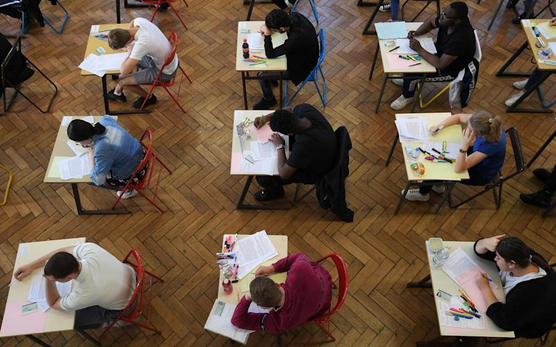 "AQA has admitted that for three years, some of its GCSE and A-level papers were ""remarked"" by the same examiner. - AFP"