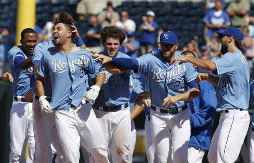 Kansas City Royals' Eric Hosmer (35) celebrates his game-winning RBI-single during the tenth inning of a baseball game against the Detroit Tigers at Kauffman Stadium in Kansas City, Mo., Wednesday, June 12, 2013. The Royals defeated the Tigers 3-2. (AP Photo/Orlin Wagner)
