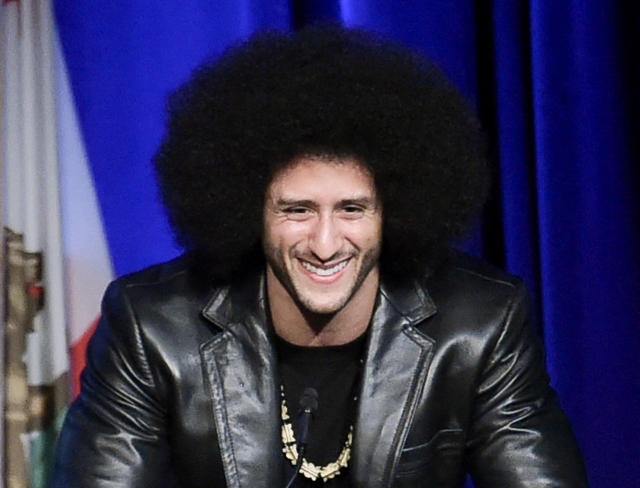 Is Colin Kaepernick really close to signing with a team? (Photo by Richard Shotwell/Invision/AP)