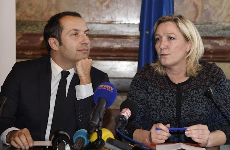 The president of the France's far-right National Front (FN) party Marine Le Pen (R) gives a press conference with Sebastien Chenu, co-founder of the Gaylib rights movement and former general secretary of the right-wing UMP party, on December 12, 2014 (AFP Photo/Dominique Faget)