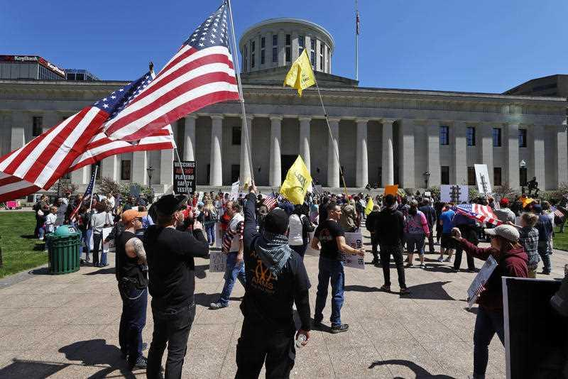 Protesters gather outside of the Ohio State House in Columbus, Ohio.