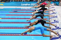 Competitors dive in at the start of the Women's 4x100m Freestyle Relay final on Day 1 of the London 2012 Olympic Games at the Aquatics Centre on July 28, 2012 in London, England. (Photo by Cameron Spencer/Getty Images)