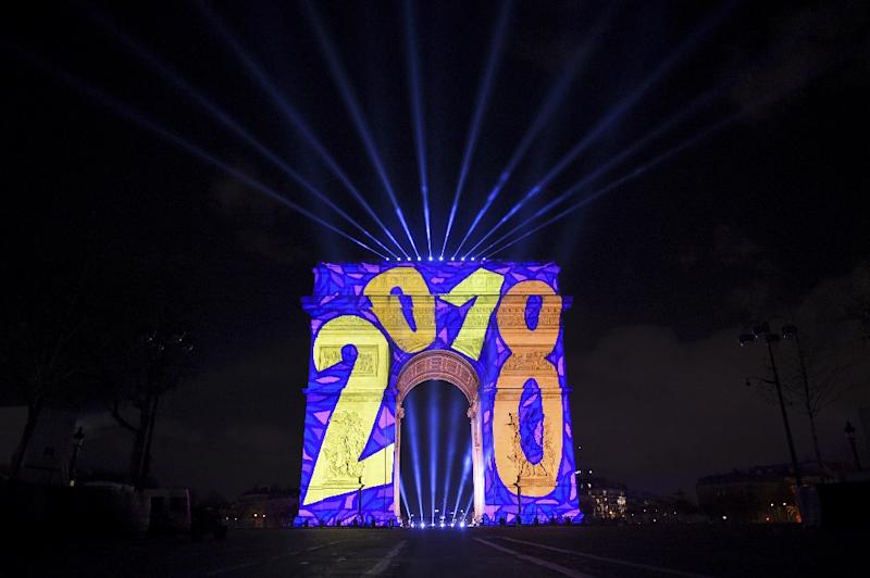 Images are projected on the Arc de Triomphe monument during the New Year celebration in Paris (AFP Photo/GUILLAUME SOUVANT)