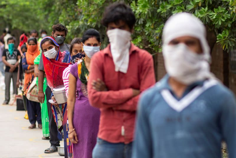 FILE PHOTO: People queue for food during the coronavirus outbreak in New Delhi, India