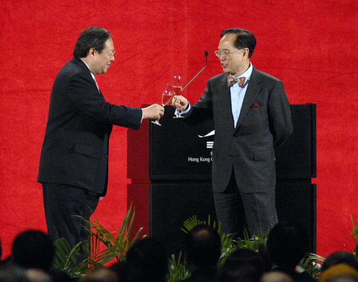 Donald Tsang, Hong Kong chief executive, right, toasts with Patrick Ho, secretary of home affairs for Hong Kong, at a reception hosted by Ho in Hong Kong in 2007. (Photo: Nelson Ching/Bloomberg via Getty Images)