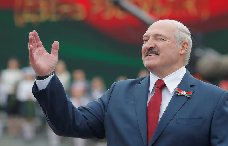 Belarus leader, jabbing at private sector opponents before election, demands higher minimum wage
