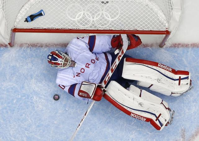 Norway's goalie Lars Haugen lies on the ice after giving up a goal to Russia's Ilya Kovalchuk, not seen, during the second period of their men's qualification round ice hockey game at the 2014 Sochi Winter Olympics, February 18, 2014. REUTERS/Brian Snyder (RUSSIA - Tags: OLYMPICS SPORT ICE HOCKEY)