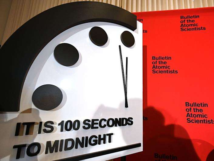 """The Doomsday Clock reads 100 seconds to midnight, a decision made by The Bulletin of Atomic Scientists, during an announcement at the National Press Club in Washington, DC on January 23, 2020. - President and CEO of the non-profit group Rachel Bronson said """"It is the closest to Doomsday we have ever been in the history of the Doomsday Clock."""" The clock was created in 1947. (Photo by EVA HAMBACH / AFP) (Photo by EVA HAMBACH/AFP via Getty Images)"""