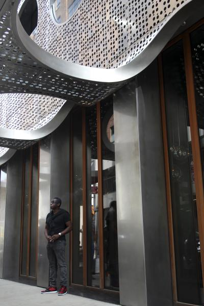 A man stands in front of the Dream Hotel in New York, Wednesday, Sept. 19, 2012. Lindsay Lohan was arrested in New York early Wednesday on charges that she clipped a pedestrian with her car and did not stop, police said. The 26-year-old actress was arrested at 2:25 a.m. as she left a nightclub at the Dream Hotel on 16th Street in Manhattan's Chelsea neighborhood, police said. They said no alcohol was involved. Lohan was charged with leaving the scene of an accident and causing injury. She was given a ticket and will have to appear in court at a later date. (AP Photo/Seth Wenig)