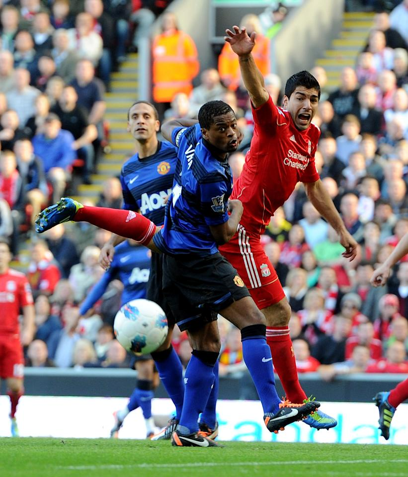 LIVERPOOL, ENGLAND - OCTOBER 15:  (THE SUN OUT) Luis Suarez of Liverpool competes with Patrice Evra of Manchester United during the Barclays Premier League match between Liverpool and Manchester United at Anfield on October 15, 2011 in Liverpool, England.  (Photo by John Powell/Liverpool FC via Getty Images)