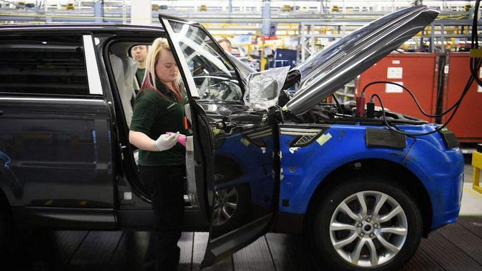 Doors being fitted and checked during production at the Jaguar Land Rover in Solihull.