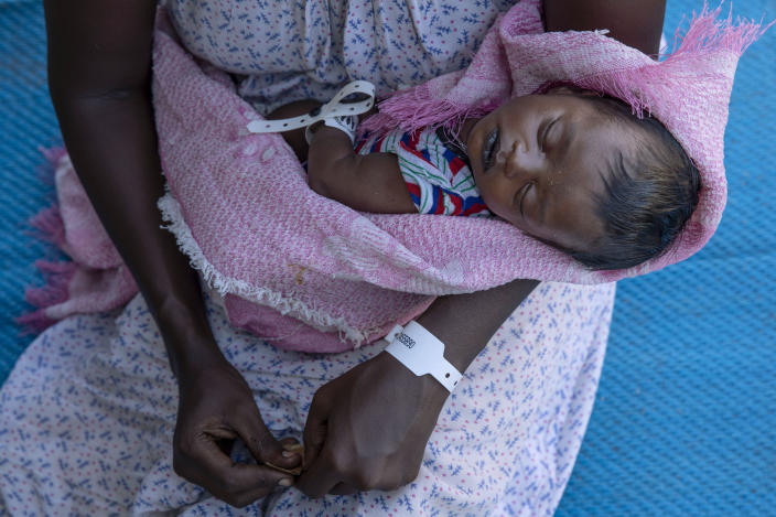 """Terhas Tsfa, 25, who gave birth on a street as she fled the conflict in Ethiopia's Tigray region, holds her baby at Um Rakuba refugee camp in Qadarif, eastern Sudan, Monday, Nov. 23, 2020. Ethiopia's government is again warning residents of the besieged capital of the embattled Tigray region as the clock ticks on a 72-hour ultimatum before a military assault, saying """"anything can happen."""" (AP Photo/Nariman El-Mofty)"""