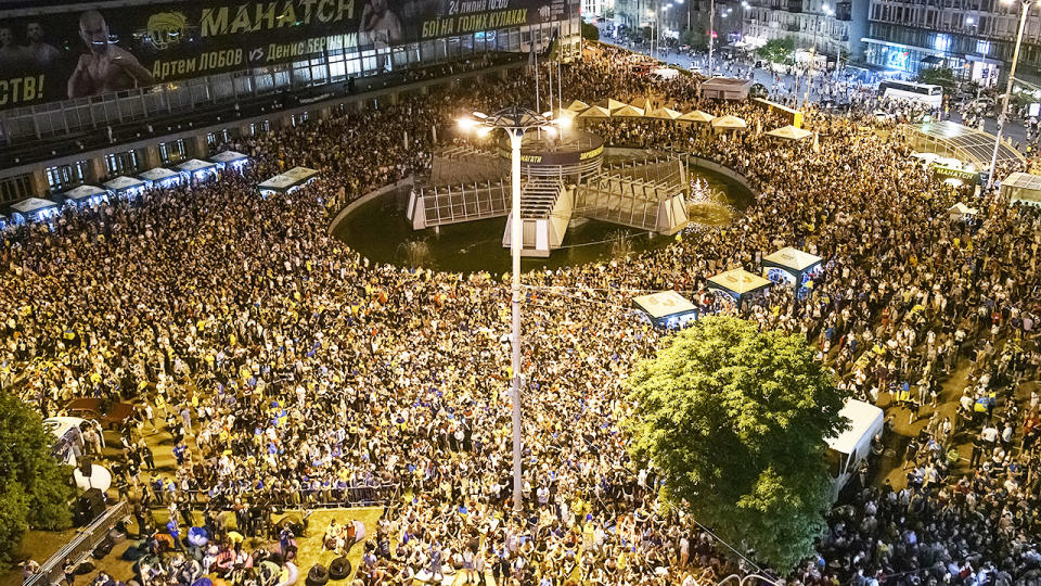 Thousands of Ukrainian football fans, pictured here cheering at the Fan Zone in downtown Kyiv, Ukraine.