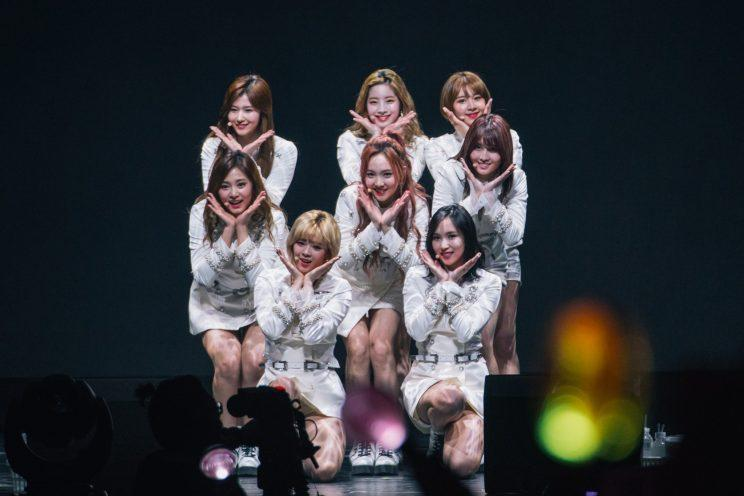 TWICE in white military band-inspired uniforms at their concert in Singapore (Photo: ONE Production)