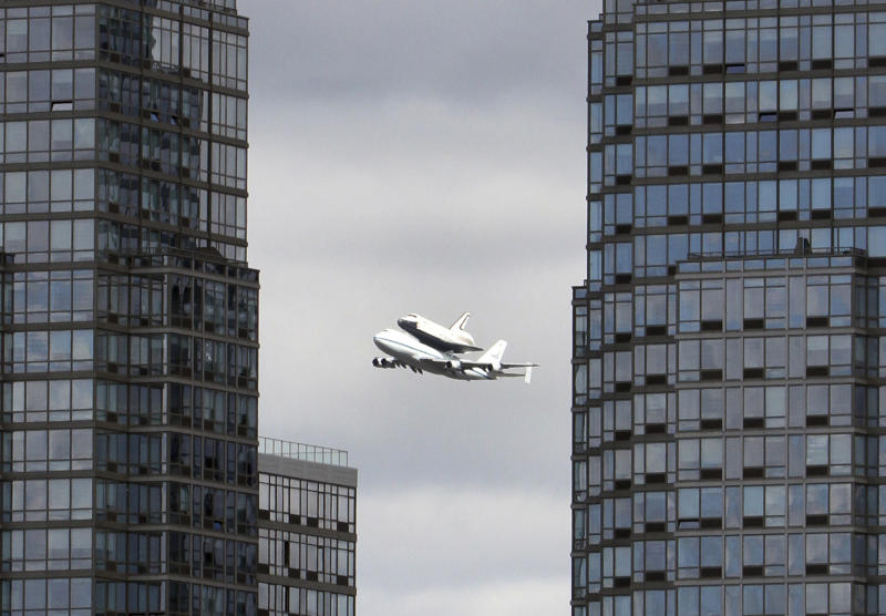 Space shuttle Enterprise, riding on the back of the NASA 747 Shuttle Carrier Aircraft, cruises over the Hudson river, Friday, April 27, 2012 in New York. Enterprise is eventually going to make its new home in New York City at the Intrepid Sea, Air and Space Museum. (AP Photo/Mary Altaffer)