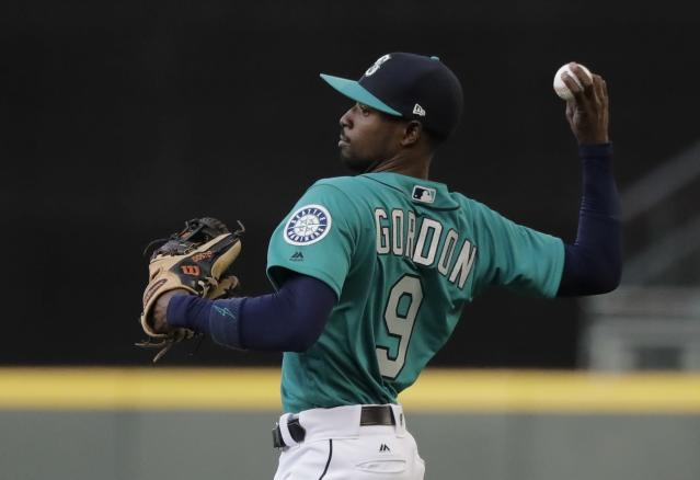 Seattle Mariners second baseman Dee Gordon returns the ball after making a catch against the Chicago White Sox during a baseball game, Friday, July 20, 2018, in Seattle. (AP Photo/Ted S. Warren)