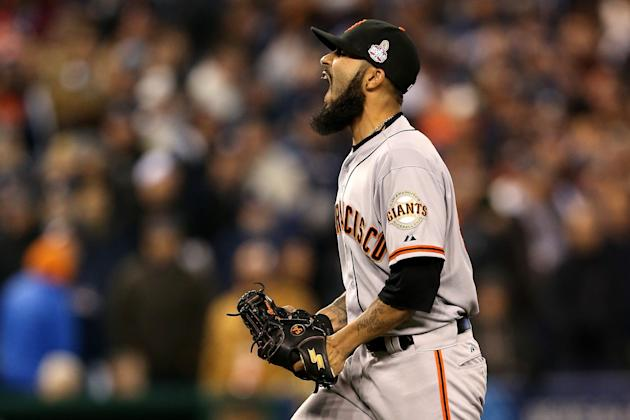 Sergio Romo celebrates after striking out Omar Infante. (Getty Images)