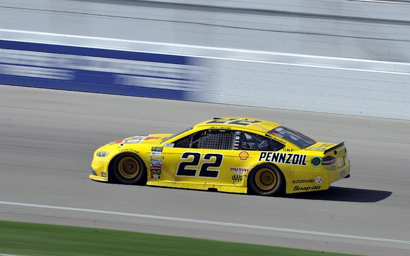 Joey Logano (22) races during a NASCAR Cup Series auto race Sunday, March 12, 2017, in Las Vegas. (AP Photo/David Becker)