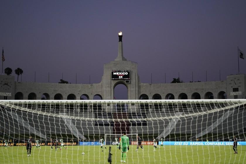 Mexico and Nigeria play the first half of their international friendly soccer match at Los Angeles Memorial Coliseum