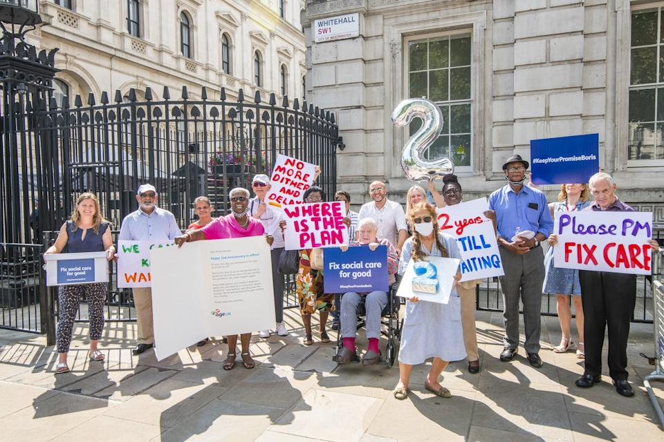 The campaigners took a petition and letter to Downing St (Jamie Lau/Age UK/PA) (PA Media)