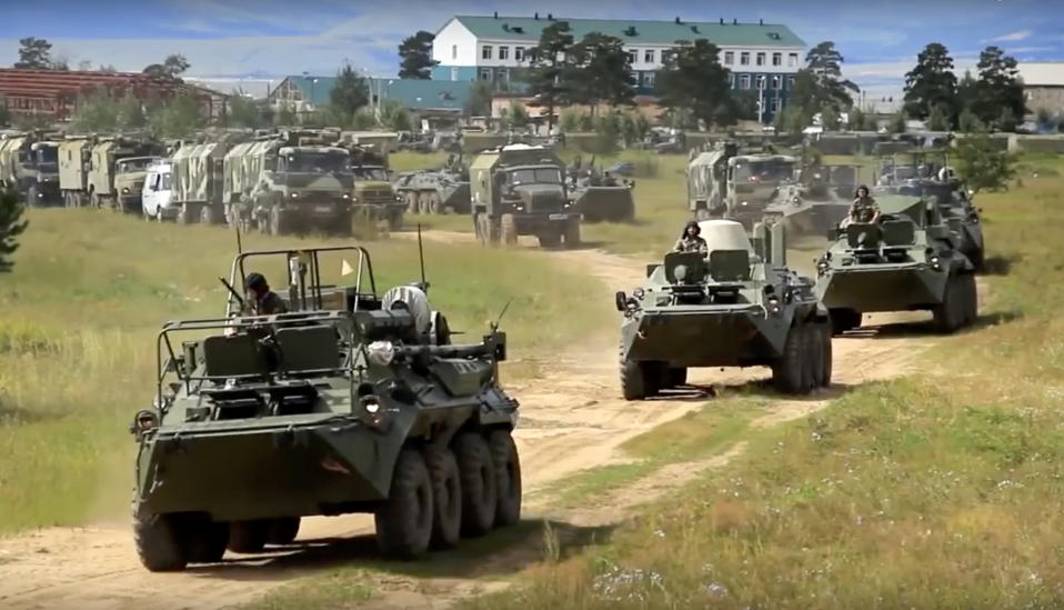 <em>Russian armoured personnel carriers roll during the military exercises (AP)</em>