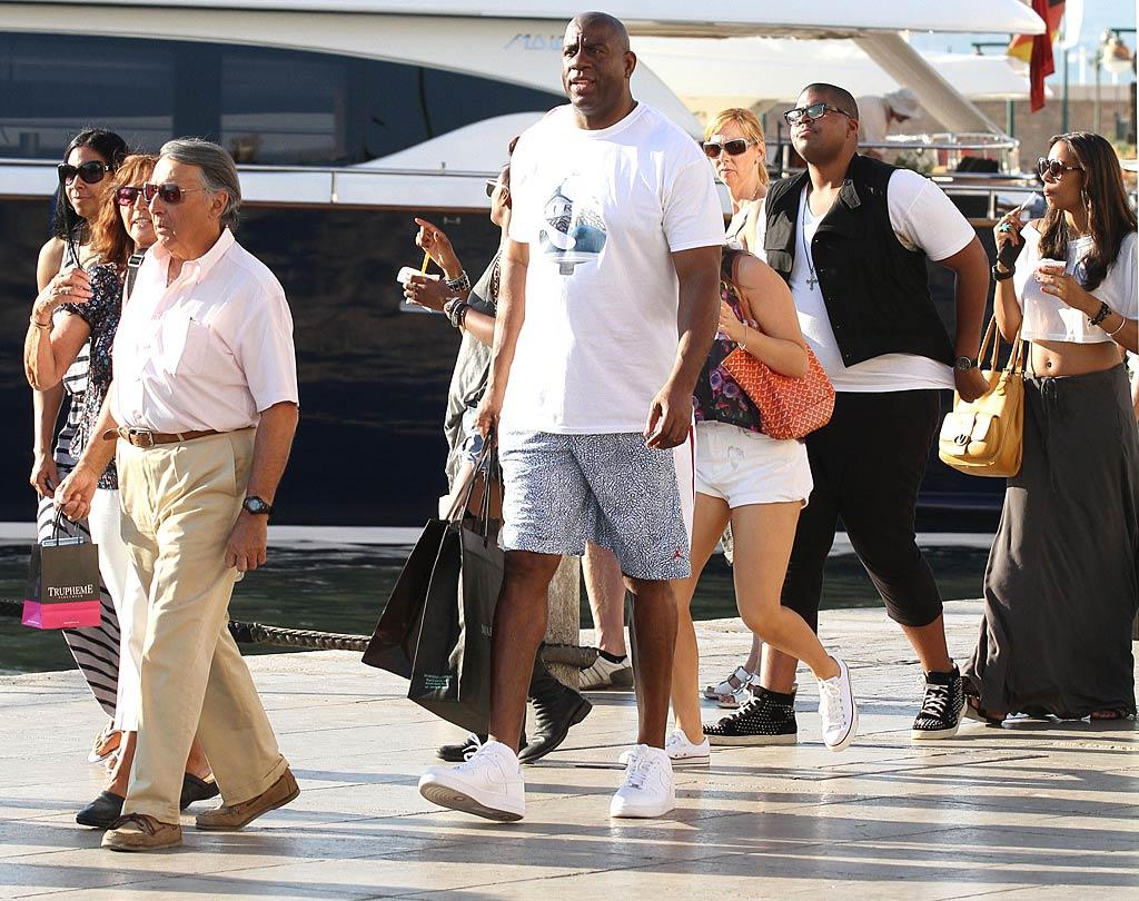 """When he takes a vacation, former NBA player Magic Johnson also likes to kick back in luxurious Saint-Tropez. And why not? It's known as the """"playground to jetsetters, fashion models, and millionaires."""" KCSPresse/<a href=""""http://www.splashnewsonline.com"""" target=""""new"""">Splash News</a> - June 25, 2011"""
